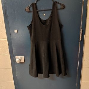 Simple plain black dress.